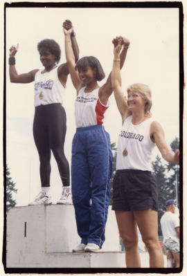 Track and field medal winners on podium
