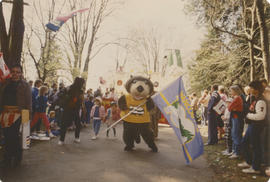 Tillicum with Centennial flag during parade in Stanley Park
