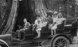 Mrs. Harry S. Baker and Wiginton family in front of the Big Hollow Tree in Stanley Park