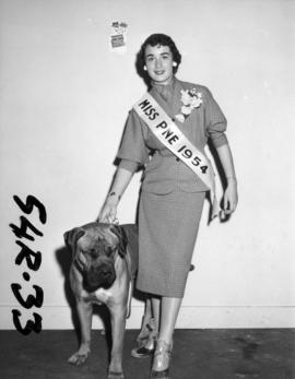 "Nancy Hansen, Miss P.N.E., with award-winning bullmastiff ""Robin"" in all-breed dog show"