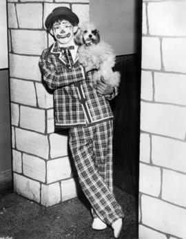 "Joe Grega and ""Minnie"" : [publicity photo of clown with dog]"
