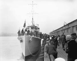 "H.M.S. ""Vancouver"" [with crowd at dockside]"