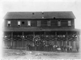 [Men in front of] C.N.P. Lbr. [Crow's Nest Pass Lumber] Co. bunk-house