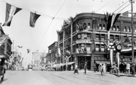 [The corner of Granville Street at Georgia Street showing street decorations for President Hardin...