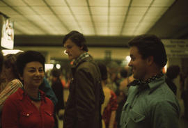 At the airport, left to right: Olga Jancic, unidentified man, Michael Prentice