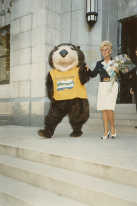 Tillicum exiting City Hall with woman holding flowers