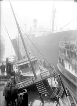 "[Union Steamship ""Ballena"" listing after fire at Union dock]"