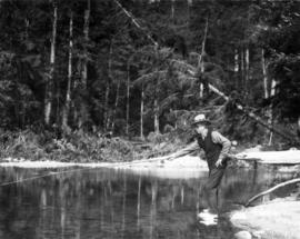 Mayor L.D. Taylor casting fishing line in creek