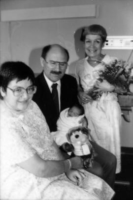 Mike Harcourt and [Leora Apsouris] visiting with the Vancouver Centennial baby [Cheryl Lynn Allan...