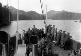 [Passengers at the bow of the Camosun]
