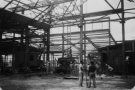 Construction of new warehouse, with workers