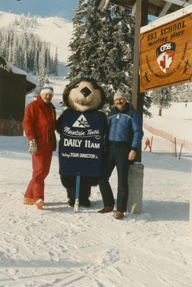 Unidentified man, Tillicum, and Mike Harcourt on ski hill