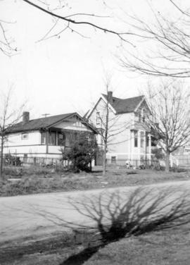 [Exterior of houses on West 65th Avenue near Granville Street]