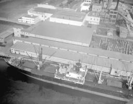 "[""James Lick""] loading at Pacific Mills [Ltd.] dock"