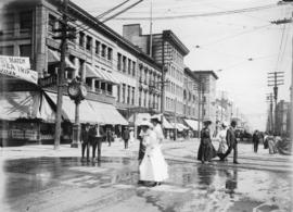 [Pedestrians crossing intersection at Granville and Hastings Streets]