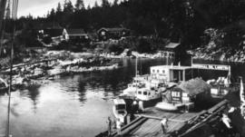[View of dock and cabins on shore]