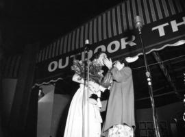 Joan Nagle being congratulated on stage after being named Miss P.N.E.