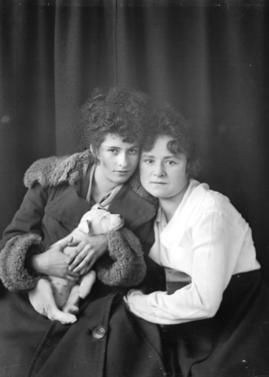 Portrait of two unidentified women and dog