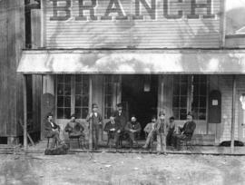 [Men and boys at the entrance to the Branch Hotel]