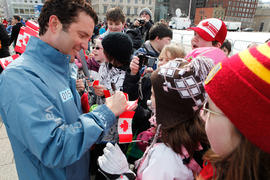 Day 1 torchbearer 15 Rick Mercer signs autographs at Community Celebration in Ottawa, Ont.