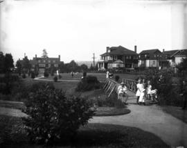 Tatlow Park, families using park facilities with homes in the background