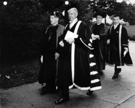 Chancellor Lett and President MacKenzie in procession with Archbishop of Canterbury Fisher and Ar...
