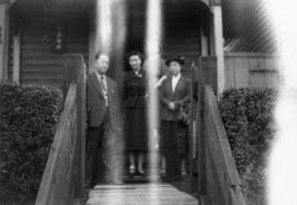 Foon Wong, Winnifred Eng, Lillian Ho Wong, and an unidentified woman at the alley entrance to 350...
