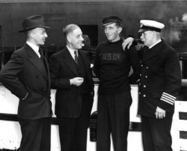 [Gerald Rushton; J. Douglas Dingwall, Chief Ticket Agent; unidentified crewman; Capt. H.E. Lawrey]
