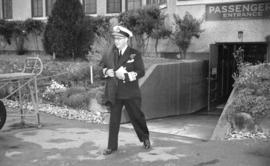 [Vice Admiral Percy W. Nelles leaving the airport]