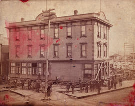 [The Dougall House being moved from the southeast corner of Cordova Street and Abbott Street]