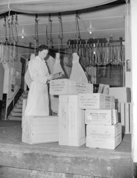 Lil Pike [inspecting boxes for shipment at] Pacific Meat [Company]