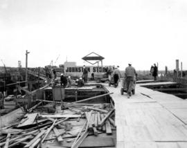 Runways and 'motobuggies' to carry the concrete for the deck [construction of bridge ra...