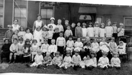 [Group portrait of children and supervisors at the City Creche - S.E. corner of Pender and Cambie...