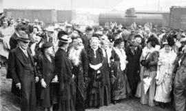 [People in period costumes during the re-enactment of the arrival of the first trans-Canada train...