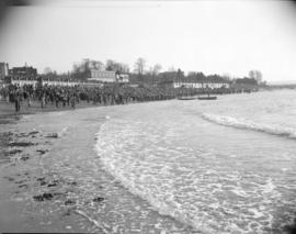 [Large crowd on the beach at English Bay]