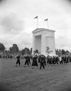 [Sea cadet band marching past the Peace Arch at the Boundary Treat Centennial celebration]