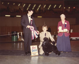Best in Show award being presented at 1974 P.N.E. All-Breed Dog Show [Miniature Poodle]