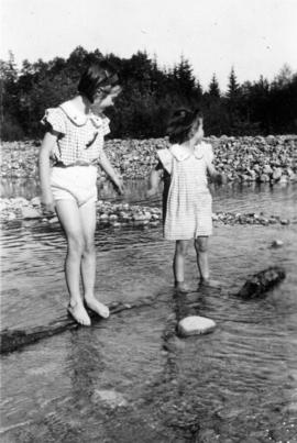 Jane Banfield and Alix Louise Gordon wading at beach