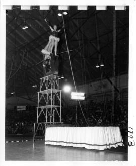 Trapeze artists performing in P.N.E. Shrine Circus
