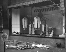 [A retail store window smashed after 'sit down strikers' were evicted from the Vancouve...