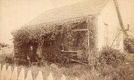 [The Caufield brothers in front of their cottage at Hastings Sawmill]