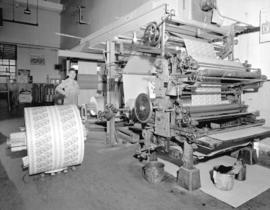 [Man operating paper machine for] Pacific Mills