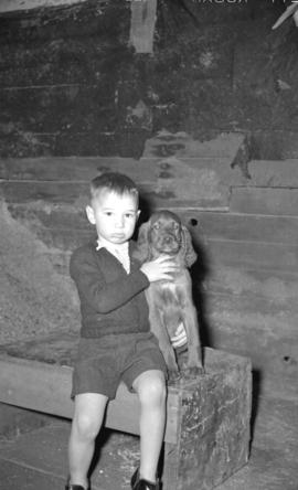 [Small boy with dog]