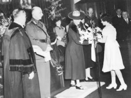 [Miss Mary Therese Buscombe presents a bouquet to H.R.H. Princess Alice in Council Chambers]