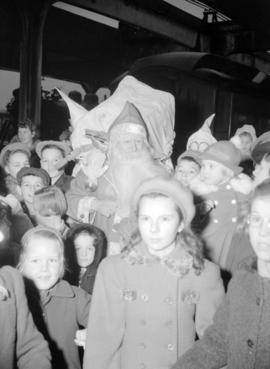 [Children with Santa Claus at a Christmas party]