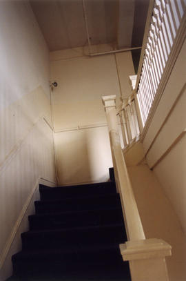 Interior stairwell of Columbia Hotel at 303 Columbia Street
