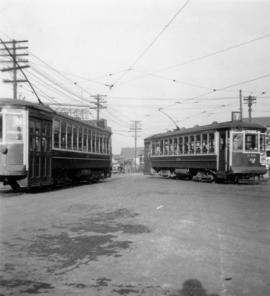 Streetcars on Kingsway at Main Street, commencement of longest paved highway in the world