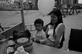 Woman and child at Mid-Summer Festival at Strathcona Community Centre