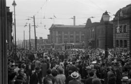[Crowds at the corner of Main Street and Hastings Street during VJ Day celebrations]