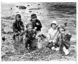 Group of children with samples of marine life from Second Beach